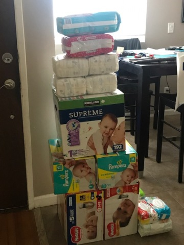 stack of diapers and baby wipes, ready for donation